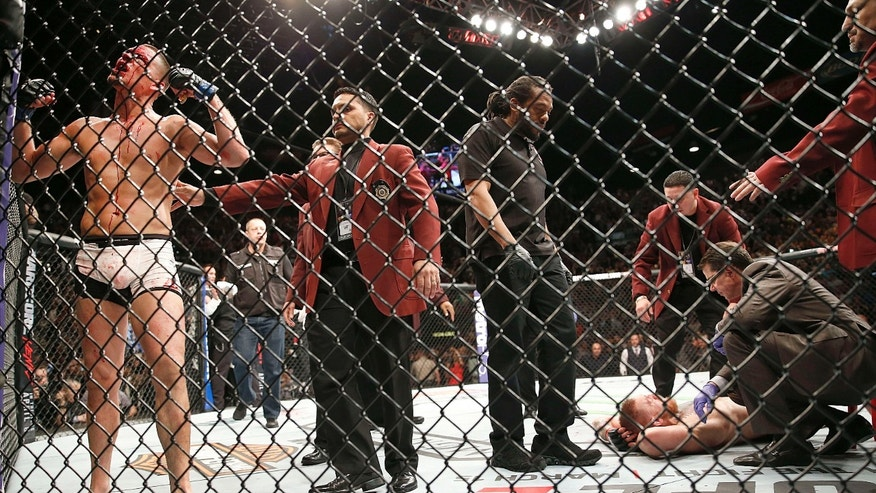 Nate Diaz, left, celebrates his second-round submission victory over Conor McGregor during their UFC 196 welterweight mixed martial arts match Saturday, March 5, 2016, in Las Vegas.