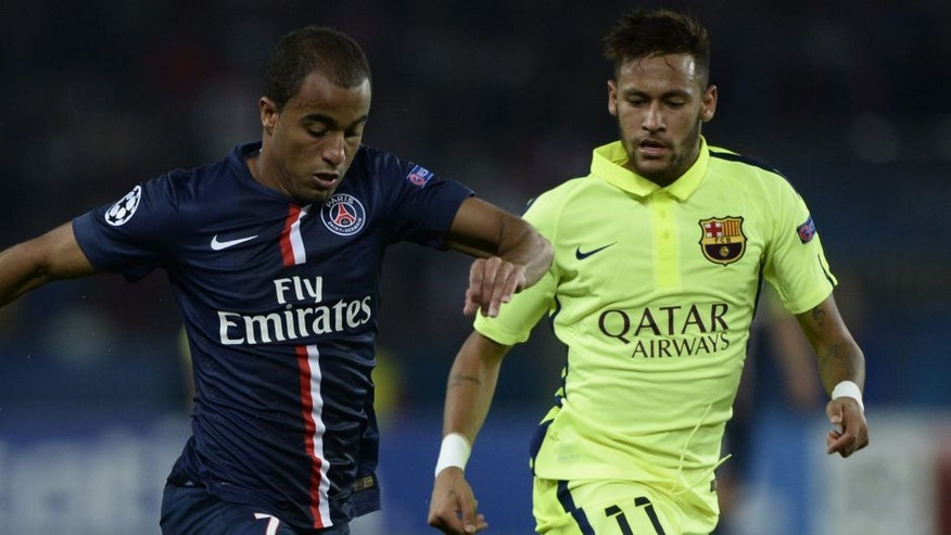 Paris' Brazilian forward Lucas Moura (L) vies with Barcelona's Brazilian forward Neymar during the UEFA Champions League football match Paris Saint-Germain (PSG) vs Barcelona (FCB) on September 30, 2014 at the Parc des Princes stadium in Paris. AFP PHOTO / FRANCK FIFE (Photo credit should read FRANCK FIFE/AFP/Getty Images)