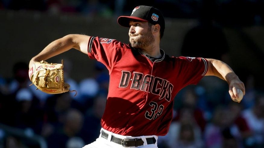 Arizona Diamondbacks starting pitcher Robbie Ray throws against the Los Angeles Angels during first inning of a spring baseball game in Scottsdale, Ariz., Tuesday, March 8, 2016. (AP Photo/Chris Carlson)
