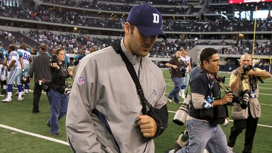 ARLINGTON, TX - OCTOBER 31:  Injured quarterback Tony Romo of the Dallas Cowboys walks off the field with his head down after the Cowboys lost 35-17 against the Jacksonville Jaguars at Cowboys Stadium on October 31, 2010 in Arlington, Texas.  (Photo by Stephen Dunn/Getty Images) *** Local Caption *** Tony Romo