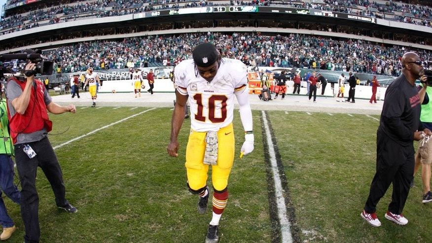 PHILADELPHIA, PA - NOVEMBER 17: Quarterback Robert Griffin III #10 of the Washington Redskins walks off the field following the Redskins 24-16 loss to the Philadelphia Eagles at Lincoln Financial Field on November 17, 2013 in Philadelphia, Pennsylvania. (Photo by Rob Carr/Getty Images)