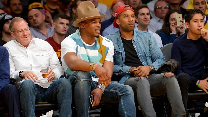 Mar 10, 2016; Los Angeles, CA, USA; Carolina Panthers quarterback Cam Newton attends the game between the Los Angeles Lakers and the Cleveland Cavaliers at Staples Center. Mandatory Credit: Jayne Kamin-Oncea-USA TODAY Sports