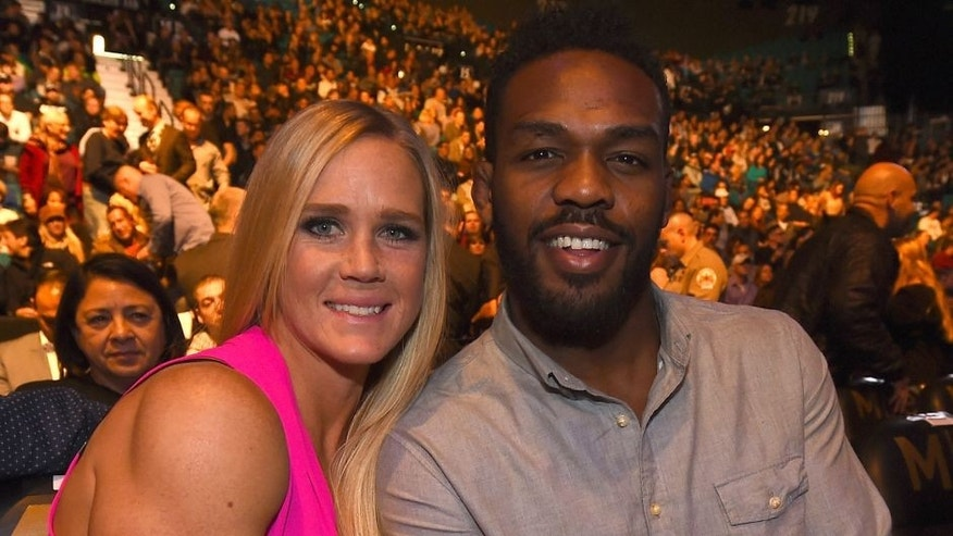 LAS VEGAS, NV - JANUARY 02: (L-R) UFC bantamweight champion Holly Holm and UFC light heavyweight Jon Jones in attendance during the UFC 195 event inside MGM Grand Garden Arena on January 2, 2016 in Las Vegas, Nevada. (Photo by Jeff Bottari/Zuffa LLC/Zuffa LLC via Getty Images)