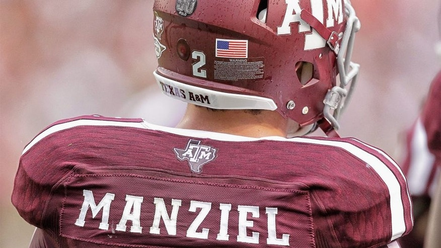 COLLEGE STATION, TX - SEPTEMBER 07: Johnny Manziel #2 of the Texas A&M Aggies during game action against the Sam Houston State Bearkats at Kyle Field on September 7, 2013 in College Station, Texas. (Photo by Bob Levey/Getty Images)
