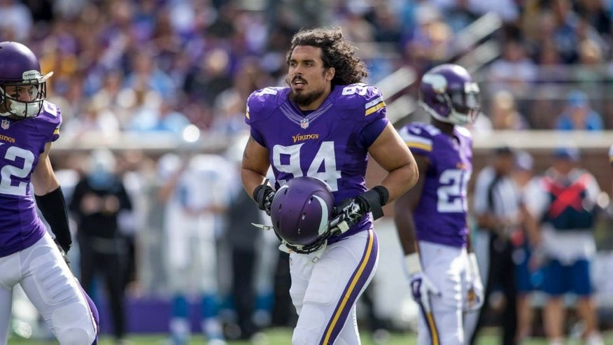 Minnesota Vikings defensive end Justin Trattou gets ready to play the Detroit Lions in the second quarter at TCF Bank Stadium in Minneapolis on Sept. 20, 2015.