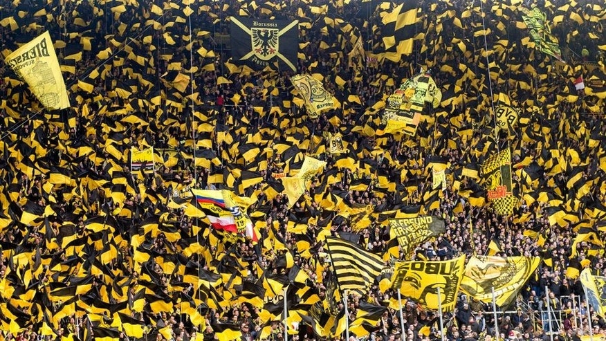 DORTMUND, GERMANY - APRIL 04: The fans of Borussia Dortmund during their choreography prior to the Bundesliga match between Borussia Dortmund and FC Bayern Muenchen at Signal Iduna Park on April 04, 2015 in Dortmund, Germany. (Photo by Alexandre Simoes/Borussia Dortmund/Getty Images)