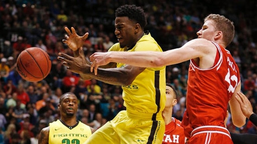 Oregon forward Jordan Bell, left, and Utah forward Jakob Poeltl battle for a rebound during the first half of an NCAA college basketball game in the championship of the Pac-12 men's tournament Saturday, March 12, 2016, in Las Vegas. Oregon won 88-57. (AP Photo/John Locher)