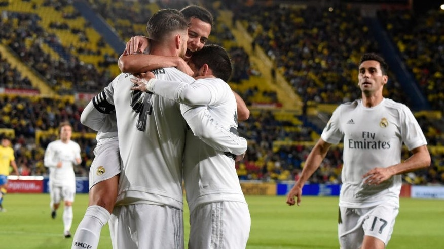 Real Madrid's players celebrate after scoring during the Spanish league football match UD Las Palmas vs Real Madrid CF at the Gran Canaria stadium in Las Palmas de Gran Canaria on March 13, 2016. / AFP / DESIREE MARTIN (Photo credit should read DESIREE MARTIN/AFP/Getty Images)
