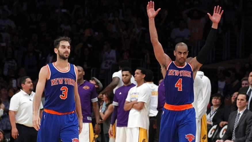 Knicks' Arron Afflalo raises his hands after Jose Calderon made a last-second shot on March 13, 2016.