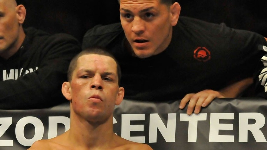 EAST RUTHERFORD, NEW JERSEY - MAY 5, 2012: Nate Diaz receives last second advice from his brother Nick Diaz in his corner before a lightweight bout at Izod Center on May 5, 2012 in East Rutherford, New Jersey. (Photo by David Dermer/Diamond Images/Getty Images)
