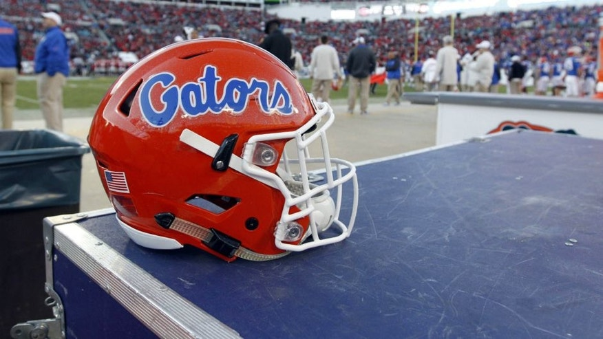 <p>Nov 1, 2014; Jacksonville, FL, USA; Florida Gators helmet during the second half against the Georgia Bulldogs at EverBank Field. Florida Gators defeated the Georgia Bulldogs 38-20. Mandatory Credit: Kim Klement-USA TODAY Sports</p>