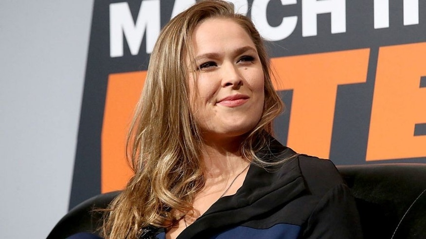 Ronda Rousey shows she is able to bite an apple again