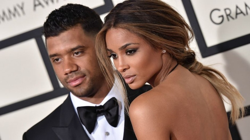 LOS ANGELES, CA - FEBRUARY 15: NFL player Russell Wilson and singer Ciara arrive at The 58th GRAMMY Awards at Staples Center on February 15, 2016 in Los Angeles, California. (Photo by Axelle/Bauer-Griffin/FilmMagic)