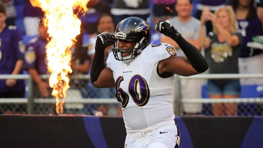 Tackle Eugene Monroe #60 of the Baltimore Ravens is introduced before the start of an NFL pre-season game against the San Francisco 49ers at M&T Bank Stadium on August 7, 2014 in Baltimore, Maryland. (Photo by Rob Carr/Getty Images)
