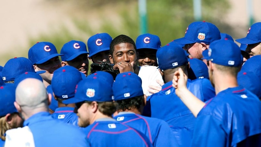 Dexter Fowler makes a surprise appearance during spring training at Sloan Park in Mesa, Ariz., on Thursday, Feb. 25, 2016, after Fowler agreed to a one-year contract with a mutual option with the Cubs. (Armando L. Sanchez/Chicago Tribune/TNS via Getty Images)