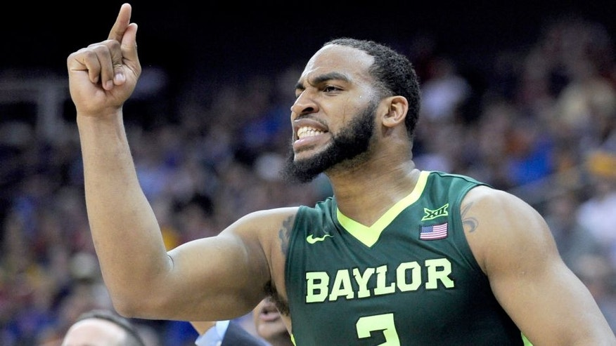 KANSAS CITY, MO - MARCH 10: Rico Gathers #2 of the Baylor Bears cheers on his team during a game against the Texas Longhorns in the second half during the quarterfinals of the Big 12 Basketball Tournament at Sprint Center on March 10, 2016 in Kansas City, Missouri. Baylor won 75-61. (Photo by Ed Zurga/Getty Images)