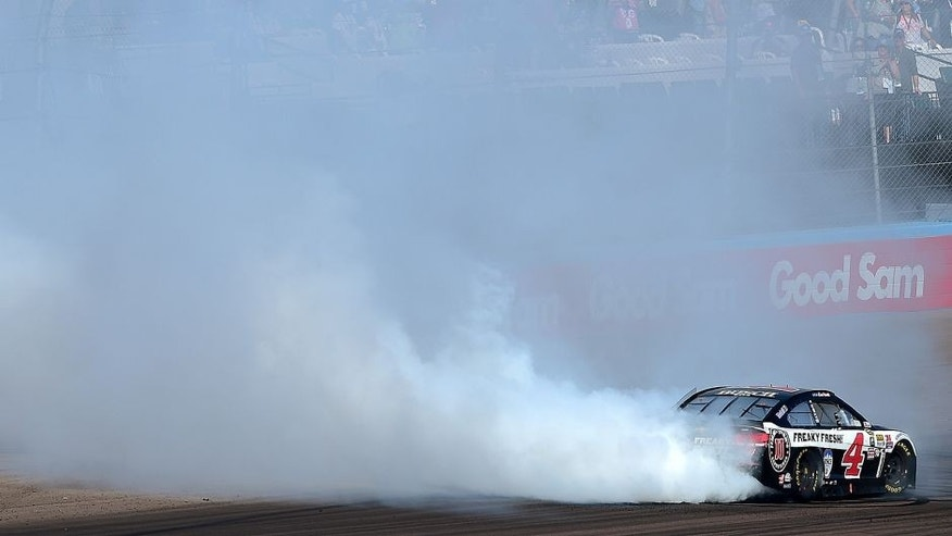 AVONDALE, AZ - MARCH 13: Kevin Harvick, driver of the #4 Jimmy John's Chevrolet, celebrates with a burnout after winning the NASCAR Sprint Cup Series Good Sam 500 at Phoenix International Raceway on March 13, 2016 in Avondale, Arizona. (Photo by Jared C. Tilton/Getty Images)