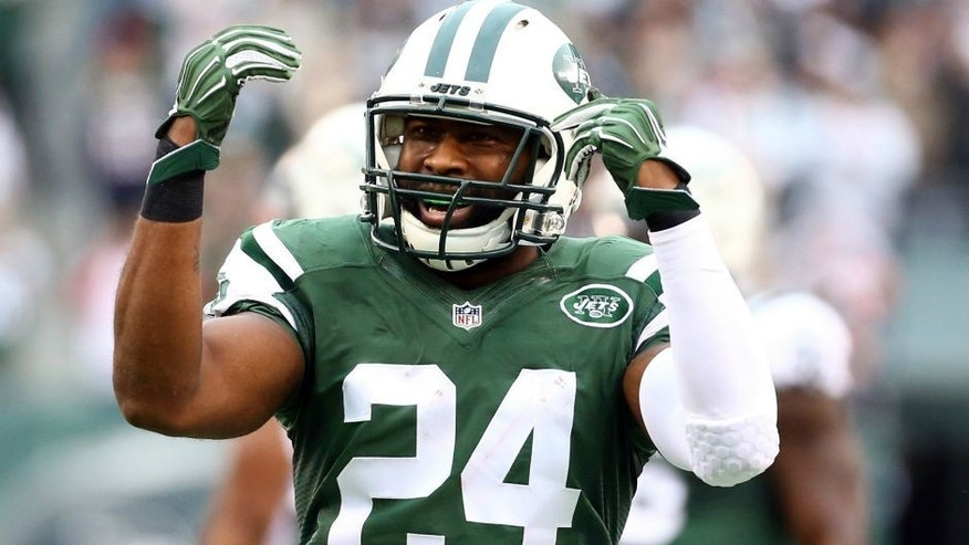 during their game at MetLife Stadium on December 27, 2015 in East Rutherford, New Jersey.,EAST RUTHERFORD, NJ - DECEMBER 27: Darrelle Revis #24 of the New York Jets reacts in the third quarter against the New England Patriots during their game at MetLife Stadium on December 27, 2015 in East Rutherford, New Jersey. (Photo by Al Bello/Getty Images)