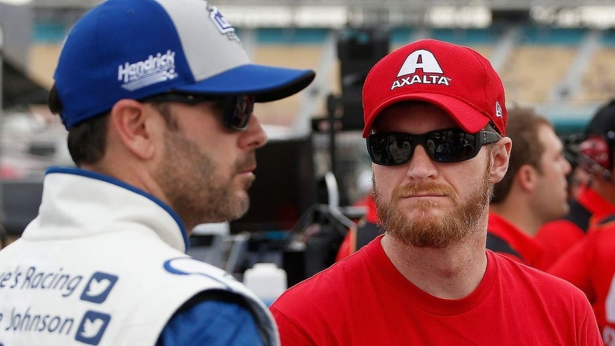 AVONDALE, AZ - MARCH 11: Dale Earnhardt Jr, driver of the #88 Axalta Chevrolet, talks to Jimmie Johnson, driver of the #48 Lowe's Pro Services Chevrolet, on the grid during qualifying for the NASCAR Sprint Cup Series Good Sam 500 at Phoenix International Raceway on March 11, 2016 in Avondale, Arizona. (Photo by Christian Petersen/Getty Images)