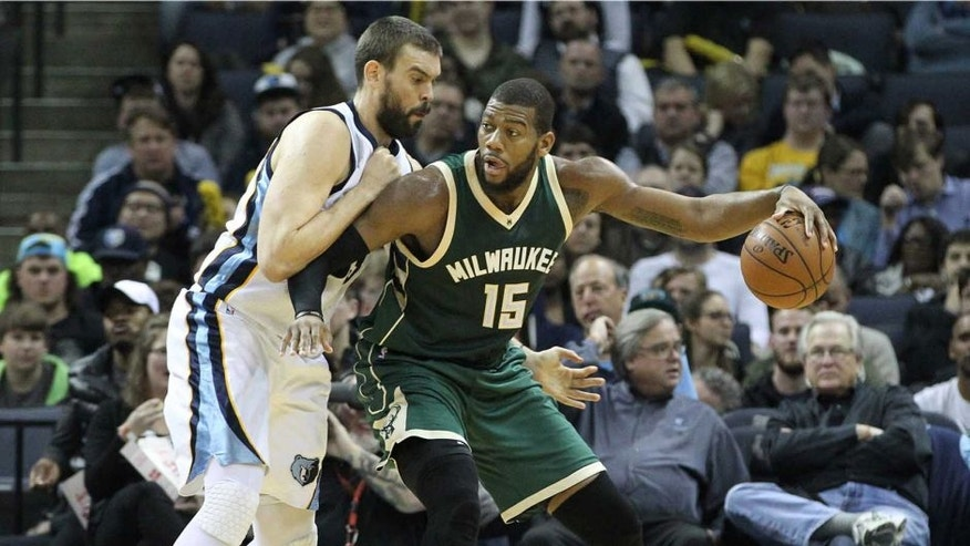 Jan 28, 2016; Memphis, TN, USA; Milwaukee Bucks center Greg Monroe (15) dribbles the ball as Memphis Grizzlies center Marc Gasol (33) defends in the second quarter at FedExForum. Mandatory Credit: Nelson Chenault-USA TODAY Sports