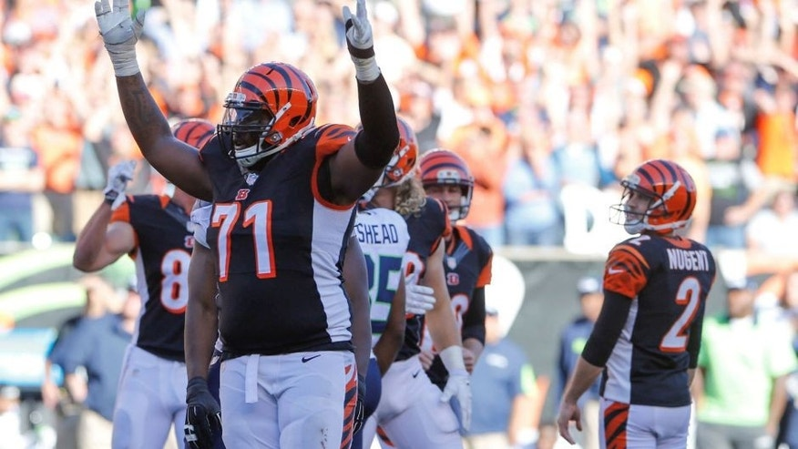 Cincinnati Bengals offensive tackle Andre Smith celebrates after his team defeated the Seattle Seahawks. Smith, a free agent, signed will sign with the Minnesota Vikings.