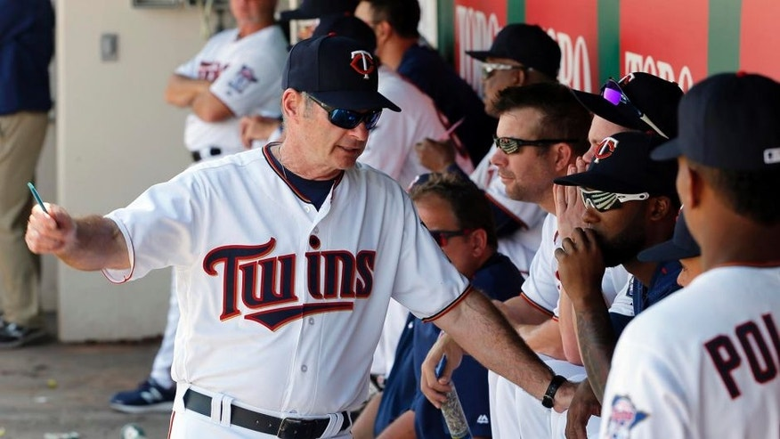 Minnesota Twins manager Paul Molitor (4) talks to a group of players in the dugout during a spring training baseball game against the Baltimore Orioles on Sunday, March 13, 2016, in Fort Myers , Fla. (AP Photo/Tony Gutierrez)