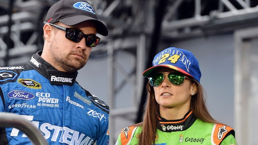 Nov 22, 2015; Homestead, FL, USA; NASCAR Sprint Cup Series drivers Ricky Stenhouse Jr. and Danica Patrick before the Ford EcoBoost 400 at Homestead-Miami Speedway. Mandatory Credit: Jasen Vinlove-USA TODAY Sports