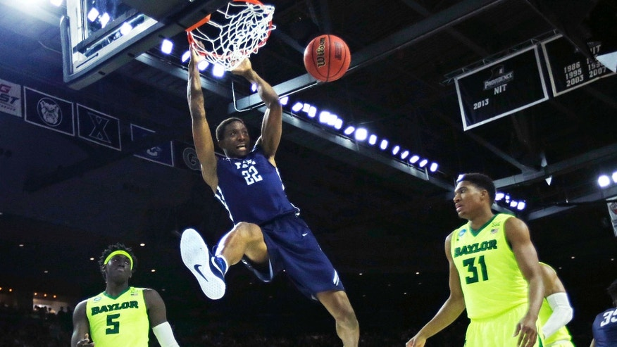 March 17, 2016: Yale forward Justin Sears (22) dunks against Baylor during the first half in the first round of the NCAA college men's basketball tournament in Providence, R.I.