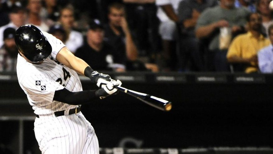 Sep 16, 2015; Chicago, IL, USA; Chicago White Sox third baseman Mike Olt (24) hits a two run home run scoring Chicago White Sox catcher Rob Brantly (36) in the fourth inning against the Oakland Athletics at U.S Cellular Field. Mandatory Credit: Matt Marton-USA TODAY Sports
