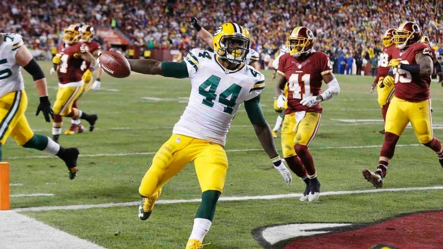 Sunday, Jan. 10: Green Bay Packers running back James Starks scores a touchdown against the Washington Redskins during the second half at FedEx Field in Landover, Md.