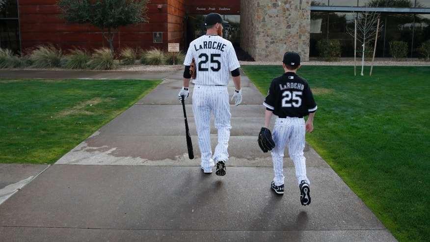 FILE - In this Feb. 28, 2015, file photo, Chicago White Sox's Adam LaRoche, left, and his son Drake walk to the White Sox's clubhouse during a photo day before a baseball spring training workout in Phoenix
