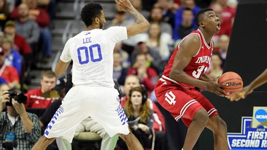 Indiana center Thomas Bryant, right, drives to the basket past Kentucky forward Marcus Lee, left, during the second half of a second-round men's college basketball game in the NCAA Tournament, Saturday, March 19, 2016, in Des Moines, Iowa. (AP Photo/Charlie Neibergall)