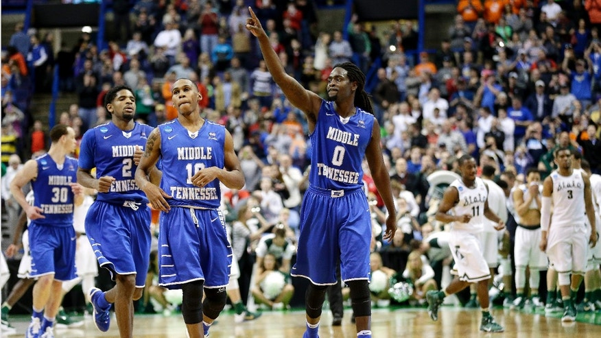 Middle Tennessee Darnell Harris (0), Jaqawn Raymond (10 ) and Perrin Buford (2) celebrate as they walk off the court after winning a first-round men's college basketball game against Michigan State in the NCAA Tournament, Friday, March 18, 2016, in St. Louis.