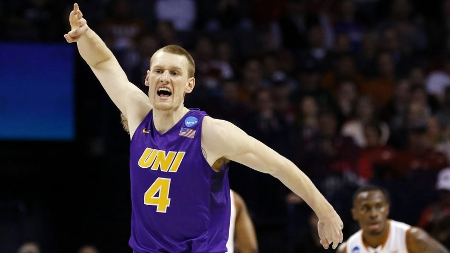 Northern Iowa guard Paul Jesperson (4) celebrates in the first half of a first-round men's college basketball game against Texas in the NCAA Tournament, Friday, March 18, 2016, in Oklahoma City. (AP Photo/Alonzo Adams)