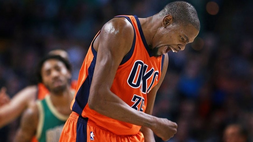 BOSTON - MARCH 16: Oklahoma City Thunder forward Kevin Durant howls in delight after teammate Randy Foye, not pictured, hit a second quarter three point shot during a game against the Boston Celtics at TD Garden in Boston on March 16, 2016.. (Photo by Jim Davis/The Boston Globe via Getty Images)