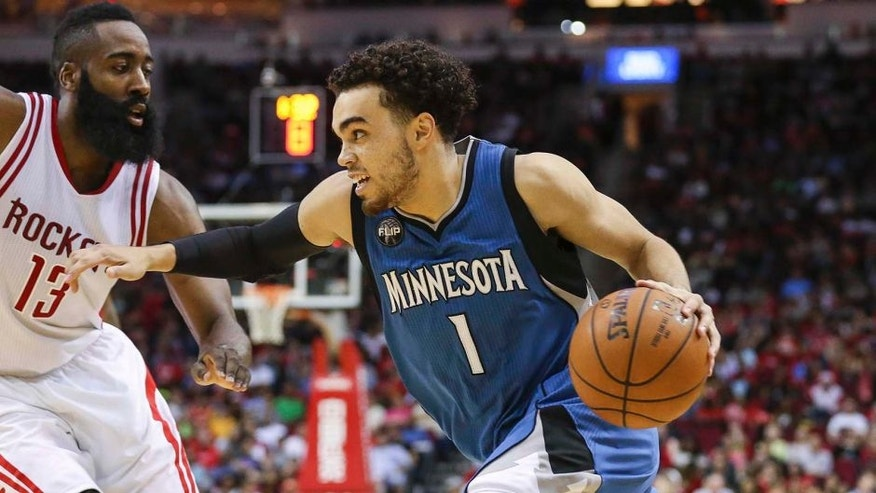 Mar 18, 2016; Houston, TX, USA; Minnesota Timberwolves guard Tyus Jones (1) dribbles the ball as Houston Rockets guard James Harden (13) defends during the third quarter at Toyota Center. Mandatory Credit: Troy Taormina-USA TODAY Sports