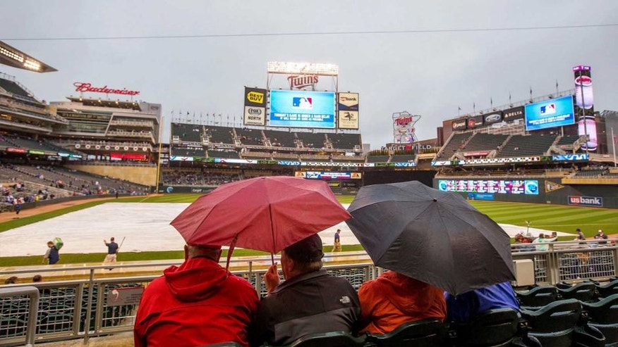 May 29, 2015; Minneapolis, MN, USA; Fans wait for the rain to clear before the start of the game between the Minnesota Twins and the Toronto Blue Jays at Target Field.