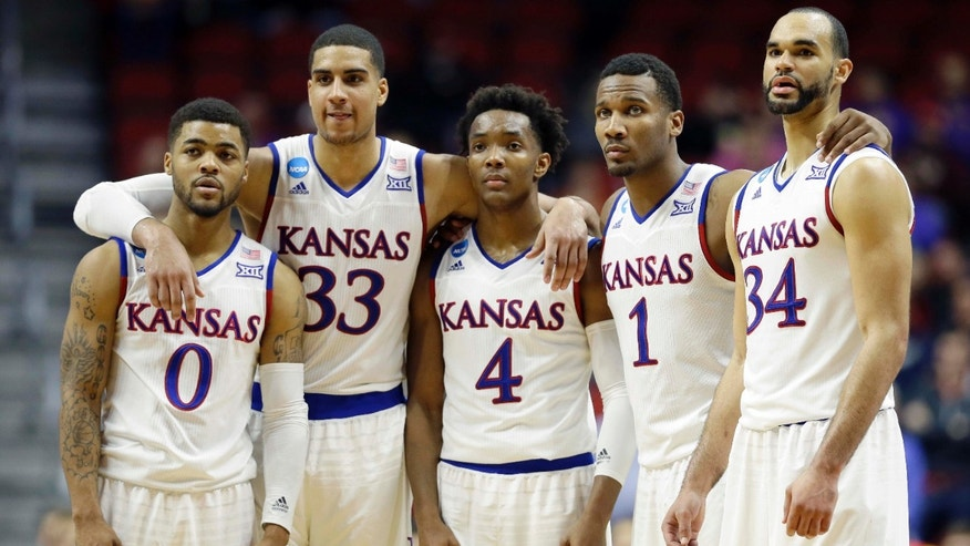 March 19, 2016: Kansas' Frank Mason III (0), Landen Lucas (33), Devonte' Graham (4), Wayne Selden Jr. (1) and Perry Ellis (34) gather during the second half of a second-round men's college basketball game against Connecticut in the NCAA Tournamen.