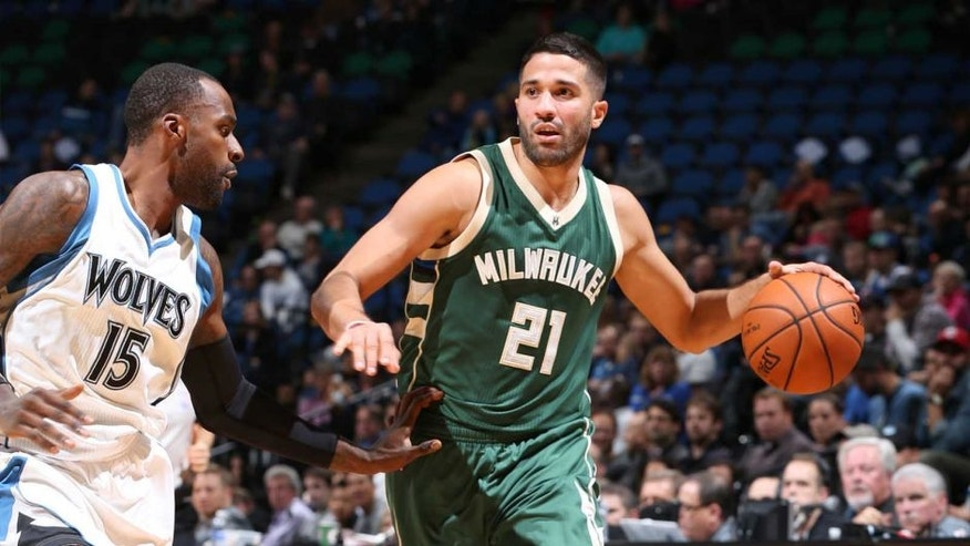 The Milwaukee Bucks' Greivis Vasquez handles the ball against the Minnesota Timberwolves during a preseason game Oct. 23, 2015, at Target Center in Minneapolis.