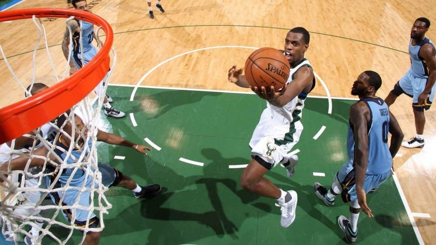 Thursday, March 17: The Milwaukee Bucks' Khris Middleton goes for the layup during the game against the Memphis Grizzlies at the BMO Harris Bradley Center in Milwaukee, Wis.