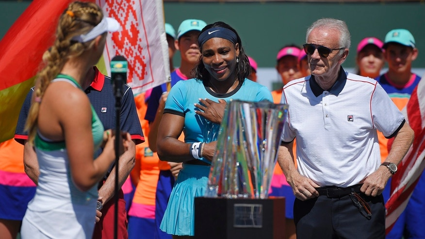 March 20, 2016: Victoria Azarenka, left, of Belarus, speaks to Serena Williams, as tournament director Raymond Moore stands by after Azarenka defeated Williams in a final at the BNP Paribas Open tennis tournament, Sunday, March 20, 2016, in Indian Wells, Calif. (AP Photo/Mark J. Terrill)