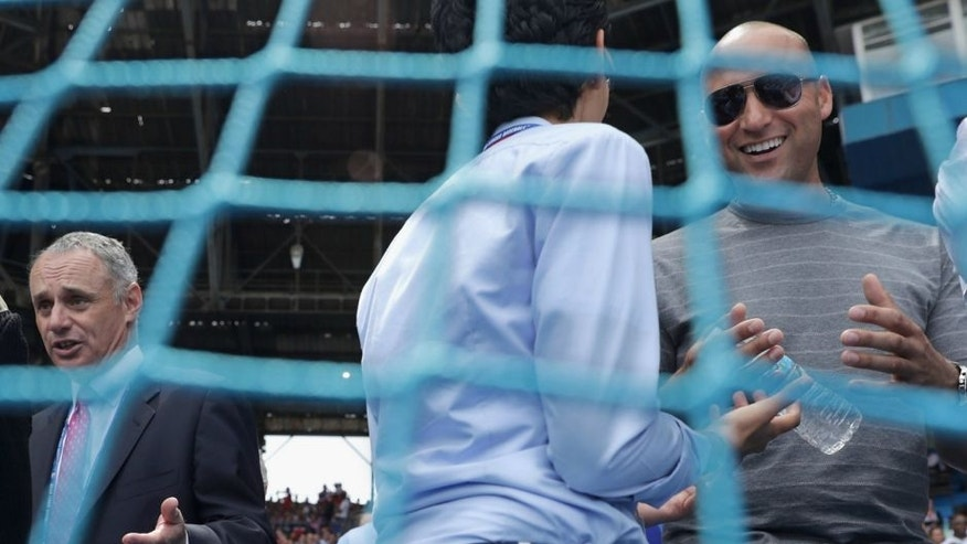 Major League Baseball Commissioner Rob Manfred (L) and former player Derek Jeter (R) visit with friends before an exhibition baseball game between the Cuban national baseball team and the Major League Baseball team Tampa Bay Devil Rays at the Estado Latinoamericano March 22, 2016 in Havana, Cuba. Cuban President Raul Castro and U.S. President Barack Obama attended the game, the first time a sittng president has visited Cuba in 88 years. (Photo by Chip Somodevilla/Getty Images)