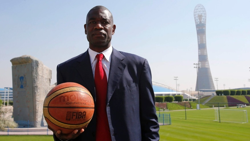 Nov. 12, 2012: ormer NBA star Dikembe Mutombo of U.S. poses before the start of a news conference at the Sports Congress and Exhibition at Aspire Dome in Doha .