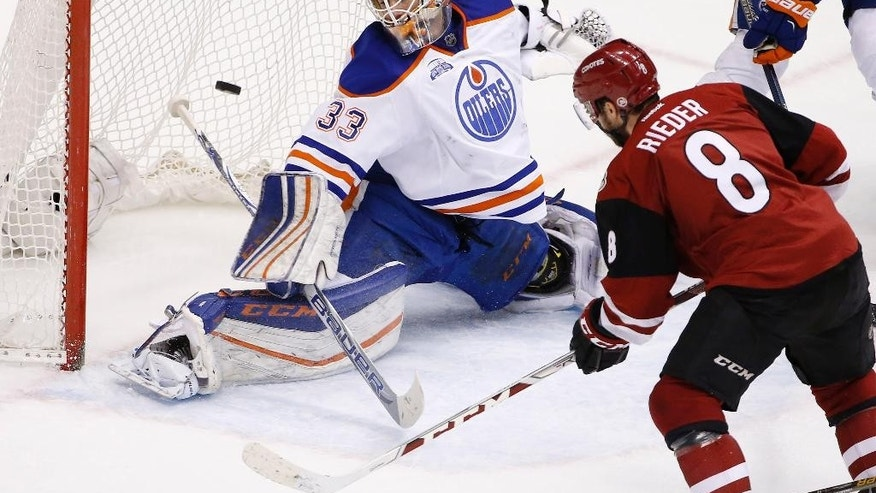 Arizona Coyotes' Tobias Rieder (8), of Germany, scores a goal against Edmonton Oilers' Cam Talbot (33) during the second period of an NHL hockey game, Tuesday, March 22, 2016, in Glendale, Ariz. (AP Photo/Ross D. Franklin)