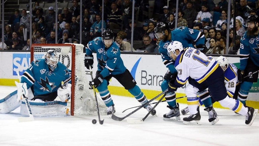St. Louis Blues' Jaden Schwartz (17) works against San Jose Sharks' Joel Ward (42) and Paul Martin (7) during the second period of an NHL hockey game Tuesday, March 22, 2016, in San Jose, Calif. (AP Photo/Marcio Jose Sanchez)
