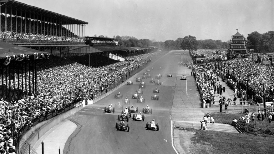 FILE - In this May 30, 1952, file photo, competitors approach the first turn at Indianapolis Motor Speedway during the 36th running of the Indianapolis 500 auto race in Indianapolis, Ind.  (AP Photo/File)
