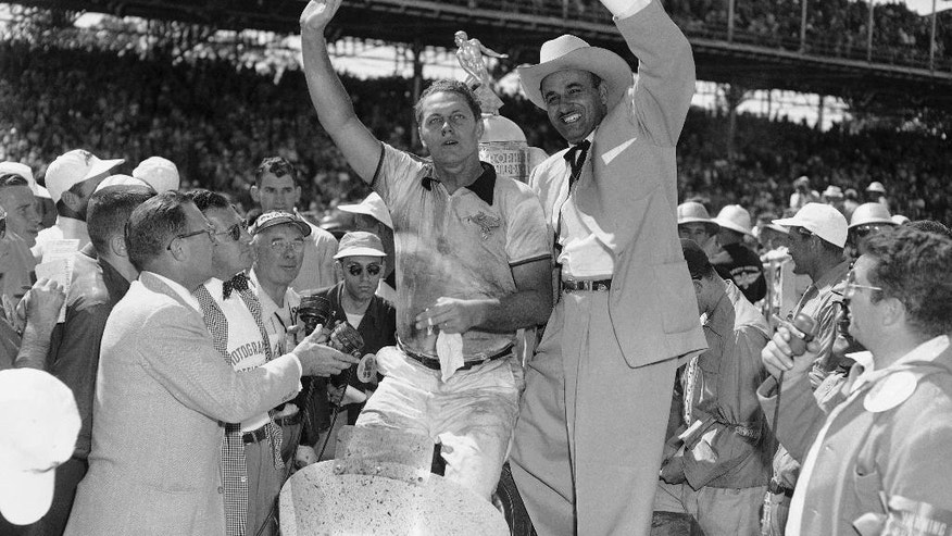 FILE - In this May 30, 1952, file photo, driver Troy Ruttman, center left, of Lynwood, Calif., and car owner J.C. Agajanian celebrate Ruttman winning the Indianapolis 500 auto race at Indianapolis Motor Speedway in Indianapolis, Ind.  (AP Photo/Charles Knoblock)