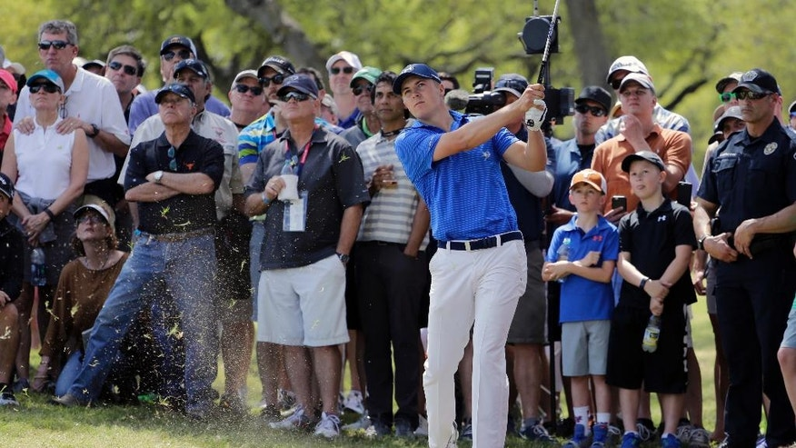 Jordan Spieth hits from the rough on the sixth hole during round-robin play against Jamie Donaldson at the Dell Match Play Championship golf tournament at Austin County Club, Wednesday, March 23, 2016, in Austin, Texas. (AP Photo/Eric Gay)