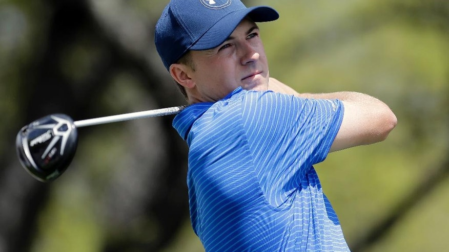 Jordan Spieth watches his tee shot on the first hole during round-robin play against Jamie Donaldson at the Dell Match Play Championship golf tournament at Austin County Club, Wednesday, March 23, 2016, in Austin, Texas. (AP Photo/Eric Gay)