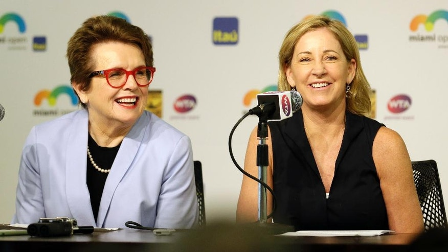"Billie Jean King, left, and Chris Evert, right, smile as they talk to reporters at the Miami Open tennis tournament in Key Biscayne, Fla., Wednesday, March 23, 2016. King and Evert talked about the resignation of the tournament director of the BNP Paribas Open, who said women's pro tennis players ""ride on the coattails of the men."" (AP Photo/Alan Diaz)"